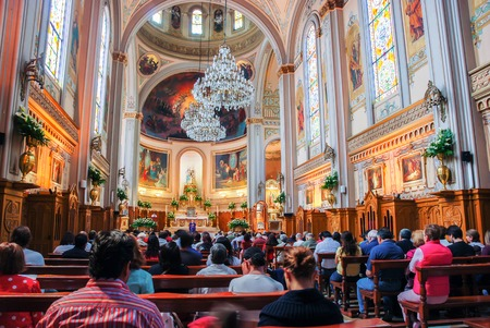 religious service: MEXICO CITY - MARCH 14, 2011: Interior of an unidentified church with people during the monday sermon