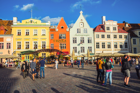 baltic people: TALLINN, ESTONIA - AUGUST 29, 2015: Old buildings, restaurants and cafes of the Town Hall square in old historical area in the popular European city of Baltic region. Unidentified people - tourists Editorial