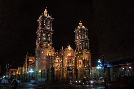Puebla Roman Catholic colonial illuminated Cathedral at night - consecrated in 1649. It is a major landmark in the city