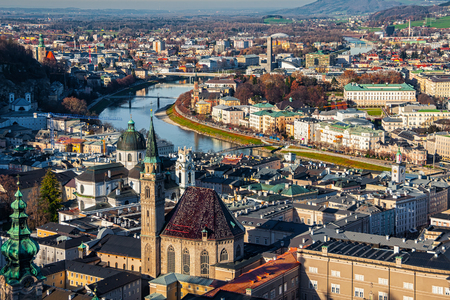 franciscan: Aerial view of Salzburg, Austria with Franciscan Church, river and mountains at the background