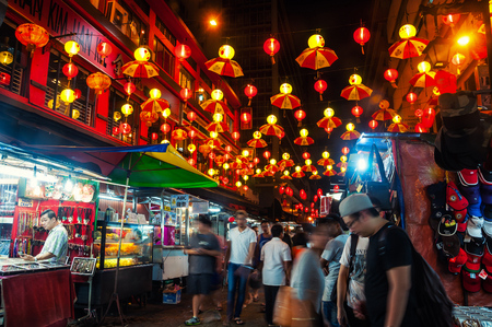 KUALA LUMPUR, MALAYSIA - MAY 2, 2014: Entrance to petaling street - the center of Chinatown. Even at night it is full of people and has a lively market Editorial