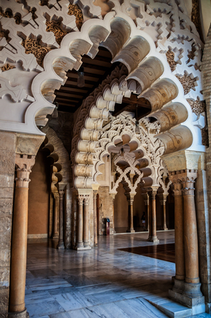 11th century: SARAGOSSA, SPAIN - JULY 12, 2013: Decorated arcs at the Aljaferia Palace - 11th century Arab castle is famous for its well preserved coffered ceilings.