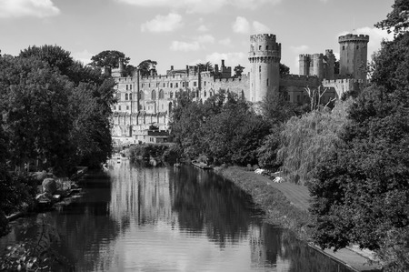 11th century: Warwick castle from outside. It is a medieval castle built in 11th century and a major touristic attraction in UK nowadays. Sunny day