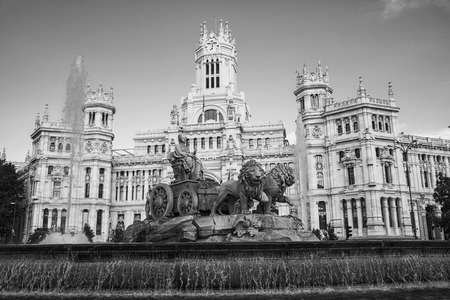 cibeles: Cybele Palace and fountain at the Plaza Cibeles in Madrid, Spain. Famous landmark in the evening with clear blue sky at the background. Black and white