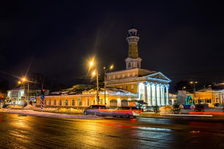 kostroma: Night view of Kostroma, Russia city center with car traffic and illuminated Fire tower Stock Photo
