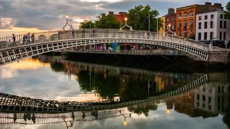 Evening view of famous Ha Penny Bridge in Dublin, Ireland