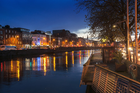 liffey: Embankment of Liffey River in Dublin, Ireland. Night view with buildings and city lights at the background