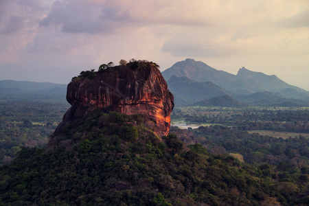 Sunset over the Lion Rock in Sigiriya, Sri Lanka. Aerial view of the tropical forest with mountains