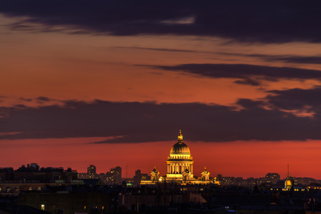 isaac: Aerial view of illuminated St Isaac Cathedral with red sunset sky. Skyline of Saint Petersburg, Russia.
