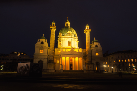 st charles: Illuminated St Charles Church at night, Vienna, Austria with dark sky