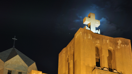 illuminator: Cross of the Saint Gregory the Illuminator Cathedral in Yerevan, Armenia at night. Illuminated roof with dark sky