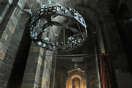 apostolic: VAGHARSHAPAT, ARMENIA - MARCH 22, 2016: Inside a Saint Hripsime Apostolic Church. It has unique architectural style and design. Chandelier with icon