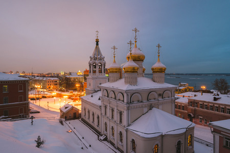Aerial view of Church of the Nativity of John the Precursor in Nizhny Novgorod, Russia at night in winter. Snow and colorful sunset sky Stock Photo