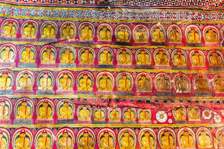 multiple images: DAMBULLA, SRI LANKA - APRIL 22, 2016: Multiple images of Buddha inside cave Golden temple.