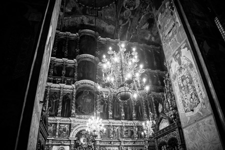 prophet: YAROSLAVL, RUSSIA - SEPTEMBER 5, 2015: Interiors of Church of Elijah the Prophet - beautiful chandelier and religious paintings made by Kostroma masters. It is a famous landmark. Black and white