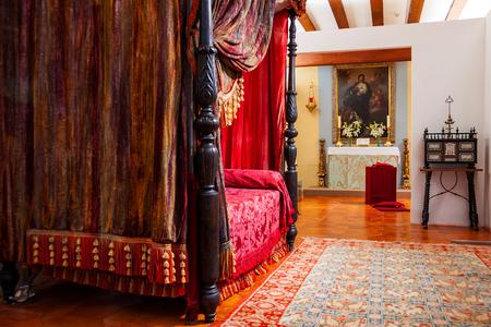 MANZANARES EL REAL, SPAIN - JULY 12, 2012: Interiors of Mendoza Castle. Bedroom with medieval decoration.