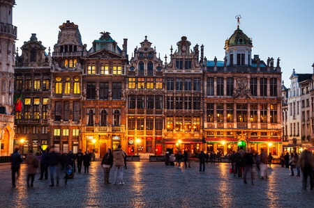 Illuminated houses at the Grand Place square at night in Brussels, Belgium