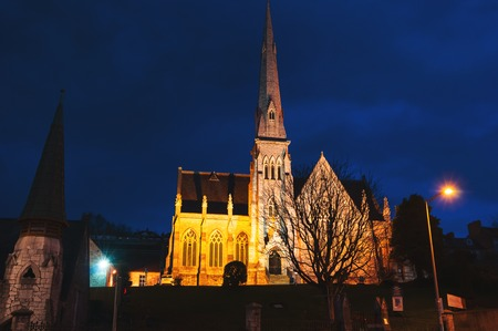 irish culture: Trinity Presbyterian Church in Cork, Ireland at night. Dark blue sky