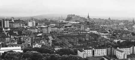 Panoramic aerial view of Edinburgh, Scotland in moody weather. Black and white