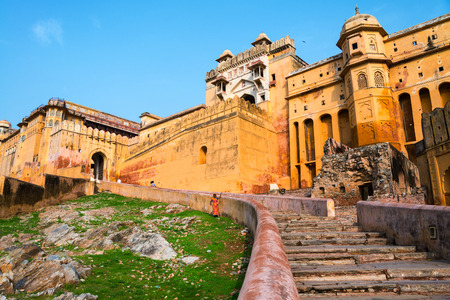 Amber Fort in Jaipur, India. Popular landmark, steps leading to the main entrance. Clear blue sky