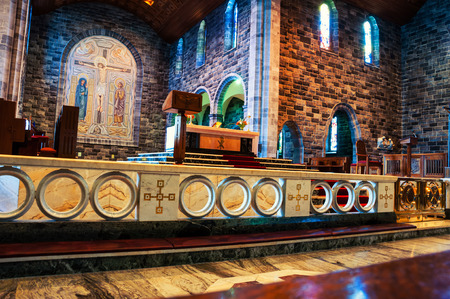 GALWAY, IRELAND - SEPTEMBER 11, 2014: Interior of a Roman Catholic Cathedral of Our Lady Assumed into Heaven and St Nicholas. Constructed in 20th century it is one of the largest buildings in the city