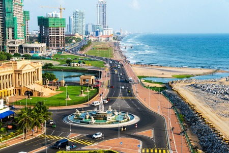 Aerial view of Colombo, Sri Lanka modern buildings with coastal promenade area. Car traffic during the day. Ocean waves Stok Fotoğraf