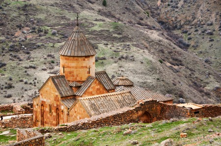 Surb Karapet St. John the Baptist Church in Armenia. Noravank monastery is a popular historical site in Armenia. Mountains at the background