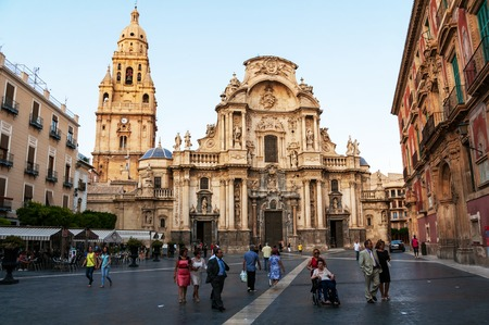 MURCIA, SPAIN - JUNE 14, 2014: Main facade of the Cathedral Church of Saint Mary in Murcia, Spain. People at the square in front of the main landmark of the city Editöryel