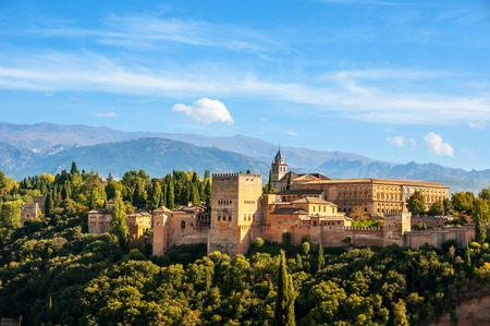 Granada, Spain. Aerial view of Alhambra Palace in Granada, Spain with Sierra Nevada mountains at the background during the sunny day