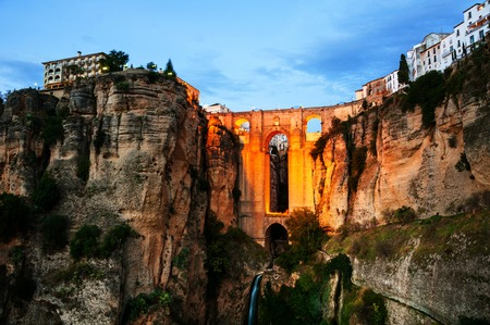 Ronda, Spain. Illuminated New Bridge over Guadalevin River in Ronda, Andalusia, Spain. Popular landmark in the evening