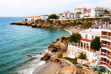 Nerja, Spain. Little touristic town Nerja in Costa del Sol, Andalusia, Spain. It has many restaurants, bars and cafes. Aerial view of the beach Stock Photo