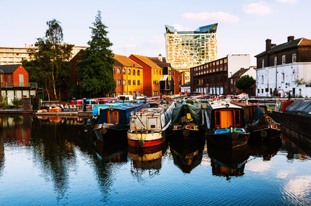 Birmingham, UK. Boats moored in the evening at famous Birmingham canal in UK Banco de Imagens - 80478456