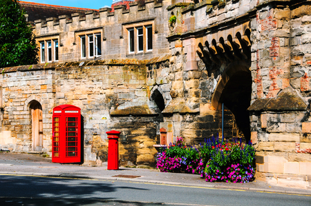 Stratford upon Avon, UK. Red british telephone booth in the historical center of Stratford upon Avon, UK
