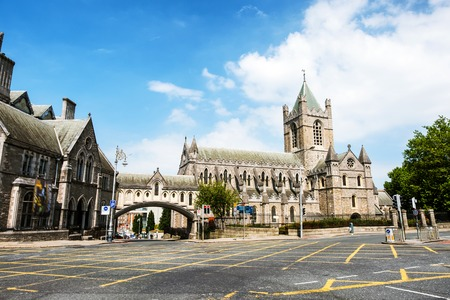 Dublin, Ireland. Car traffic with the Christ Church Cathedral during the sunny day in Dublin, Ireland. Cloudy sky Stock Photo