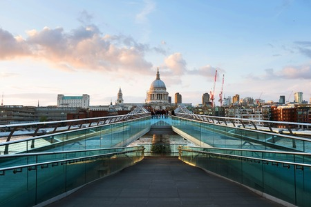 Millennium bridge with Saint Paul Cathedral in the evening in London, UK