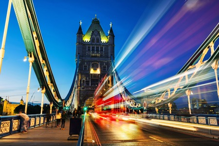 Car traffic at Tower bridge at night in London, UK Stock Photo