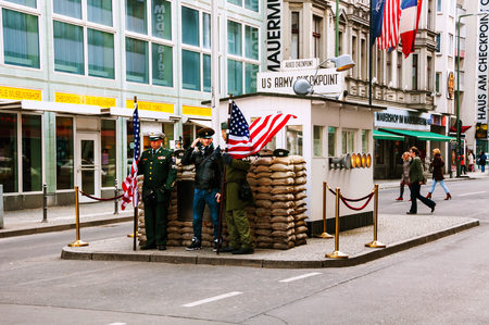 American soldiers in front the Checkpoint Charlie in Berlin, Germany Editorial