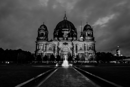 Berlin, Germany. View of Evangelical Cathedral located on the Museum Island in Berlin, Germany. Sunset with dark cloudy sky. Black and white