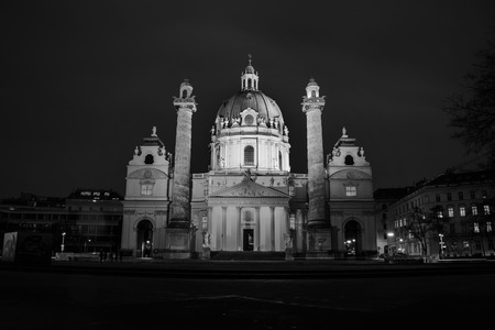 Vienna, Austria. Illuminated St Charles Church at night, Vienna, Austria with dark sky. Black and white