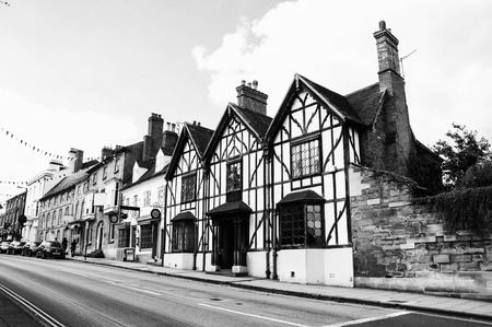 Stratford upon Avon, UK. Old historical buildings of the Stratford upon Avon, UK - a popular tourist destination and a birthplace of the playwright and poet William Shakespeare. Black and white