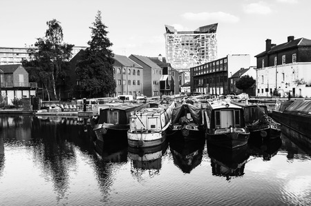 Birmingham, UK. Boats moored in the evening at famous Birmingham canal in UK. Black and white