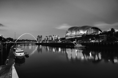 Newcastle upon Tyne, UK. Famous Millennium bridge at night. Illuminated landmarks with river Tyne in Newcastle, UK. Black and white Stock Photo