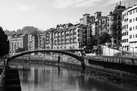 pedestrian bridges: Bilbao, Spain. City downtown with a Nevion River and historical buildings in Bilbao, Spain. It is a capital of Basque country and major city in Spain. Black and white
