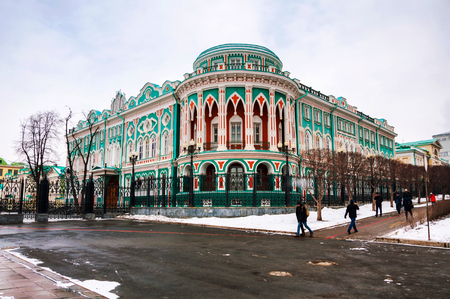 Yekaterinburg, Russia. House of Sevastyanov in Yekaterinburg, Russia in spring. Built in 1866 with architectural style eclecticism. Snowy streets, cloudy sky