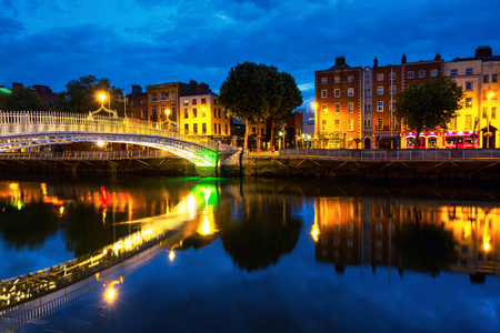 Morning view of famous illuminated Ha Penny Bridge in Dublin, Ireland