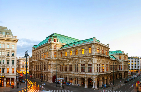 Vienna, Austria. View of State Opera in Vienna, Austria during the evening. Bright blue sky, car light trails
