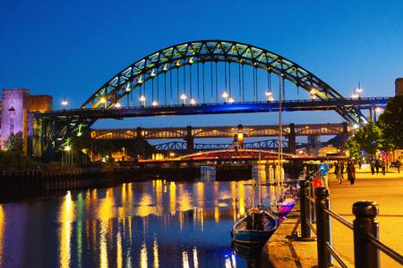 Newcastle upon Tyne, UK. The Tyne Bridge in Newcastle upon Tyne, UK, over river Tyne during night with the High Level Bridge behind it