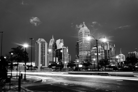 Atlanta, USA. Illuminated Midtown in Atlanta, USA at night. Car traffic, illuminated buildings and dark sky. Car traffic trails. Black and white