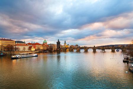 Charles Bridge over Vltava river in Prague, Czech Republic during the sunset
