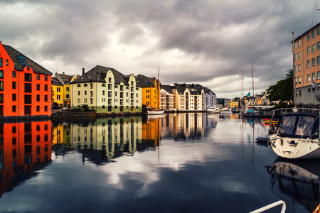 View of center of Alesund, Norway during a cloudy day with reflection